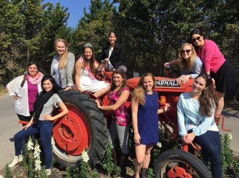 girls on a tractor.